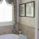 Master Bathroom With French Motif Wallpaper and Swag Window Treatment