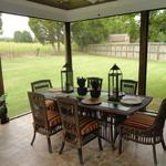 Screened Porch Dining Area with Outdoor Views