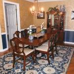 Beautiful Blue and Gold Dining Room in Newly Decorated Condo