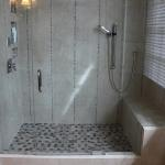 New modern shower with bench seating.